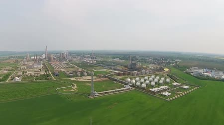 industrialization : Array of spherical metallic pressurized natural gas storage reservoirs as part of the refining process of an oil refinery aerial shot