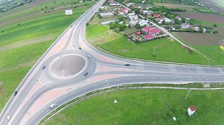 priority : Road traffic roundabout with oncoming vehicles , aerial view