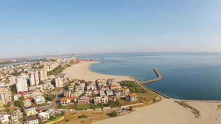levee : Aerial view of Constanta , major city on the Black Sea coast, Eastern Europe , Tomis beach with lakes in the background and Mamaia holiday resort, a top travel destination on the Romanian seaside , drone footage