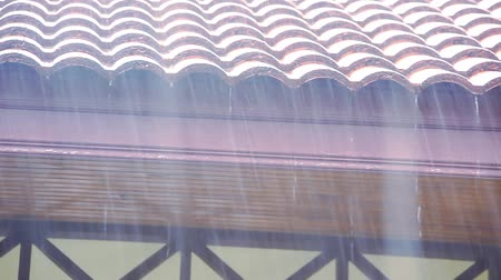 tin roofs : Rain runs off the roof. Video shift motion