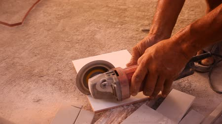 çini : Close up of craftsman is cutting floor tile with portable angle grinder. Video have a sound