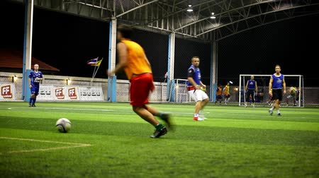 piłka nożna : THAILAND, KOH SAMUI, FEBRUARY 2, 2014: Soccer players on the field  at night with lighting. Video