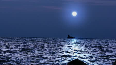 strand : Ship sails under the moon in magical night on Koh Samui