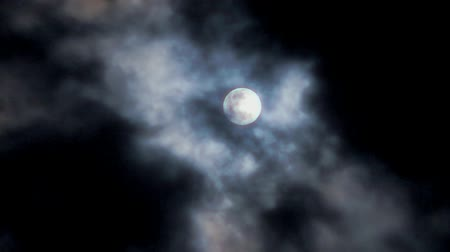 полный : Magic full moon and white clouds on nightly sky