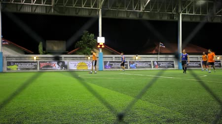 trest : THAILAND, KOH SAMUI, 16 july 2014 Soccer players on the field at night with lighting Dostupné videozáznamy