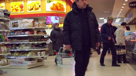 bakkal : RUSSIA, MOSCOW, 7 MARCH 2015, 4k Timelapse speed up. People shopping at the grocery supermarket. Stok Video