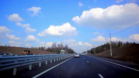 straight road : Cars drives on the asphalt road and sky background with clouds Stock Footage