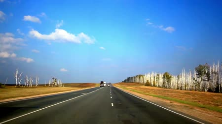 high speed road : Cars drives on the asphalt road and sky background with clouds Stock Footage