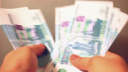 poke : Women hands counting Russian banknotes
