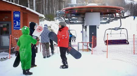 winter place : happy smile friends with snowboards go to ski lift in winter