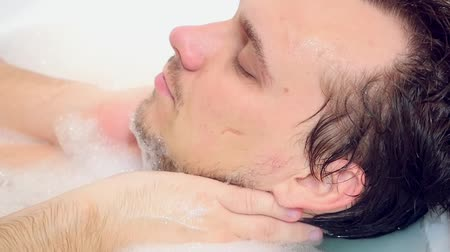 wanna : Young bearded guy having a foam bath relaxing