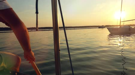 sucção : Sailor with paddle surf in slowmotion  at the amazing sunset over the sea on a yacht Stock Footage