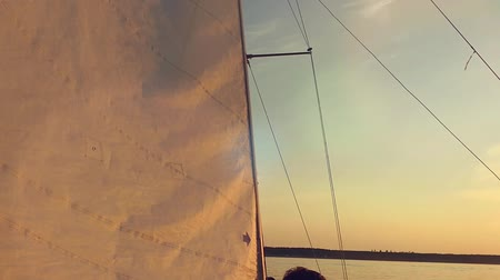 zengin : Young people on sailing yacht.  Traveling at sunset in slowmotion. Stok Video