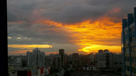 urban skyline : Timelapse of City during warm amazing sunset and beautiful sky