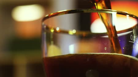 bares : dark beer is pouring into a glass,
