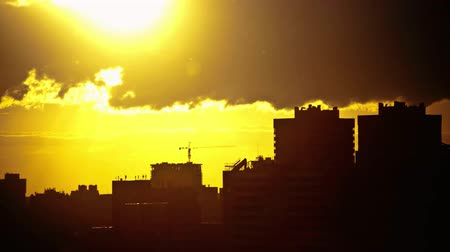 sunset city : Sunset over downtown city skyline on silhouette of architecture