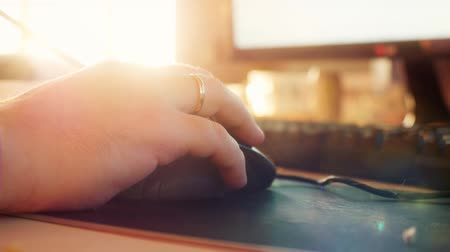 clique : Close up of men hands typing on computer keyboard and mouse with changing focus and lens flare with sunshine. 1920x1080 Stock Footage