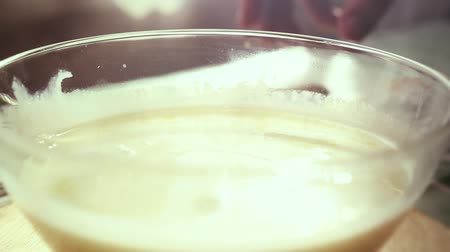 смешивание : Mixing Batter or dough in slowmotion on sunny background. 1920x1080