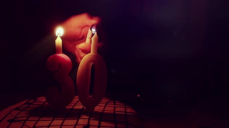 dilek : Lights candles on Birthday cake in the dark in slowmotion. 1920x1080