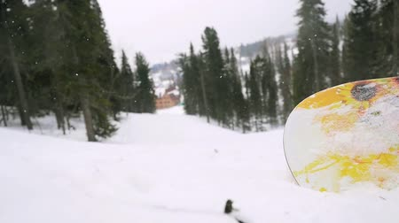 fur boots : Snowboarder sitting in the mountains during a snowfall at blizzard. 1920x1080 Stock Footage