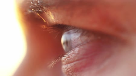 eyes closed : Extreme macro close up of male eye watching sunset by the sea. Enjoying nature in slow motion, HD. 1920x1080