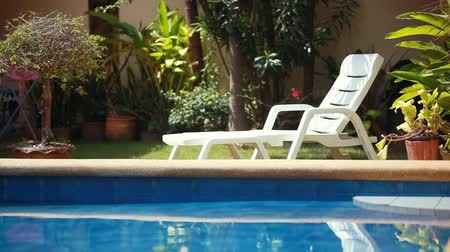 clubhouse : Tropical paradise. Sunbed lounger near the swimming pool. 1920x1080 Stock Footage