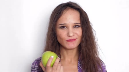 eat background : Healthy smiles young brunette woman eating green apple. Slow motion. 3840x2160