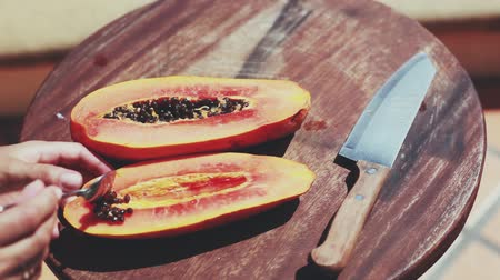 clearing the table : Clearing a papaya fruit preparing for eating or making smoothies. 1920x1080 Stock Footage