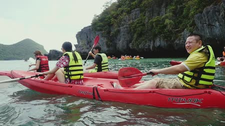 haver : Angtong marine park. Thailand. 14 february 2016. Tourists in life jackets, approaches a cliff in the sea in active wear on kayak boat on a hot sunny summer day. slow motion. 1920x1080