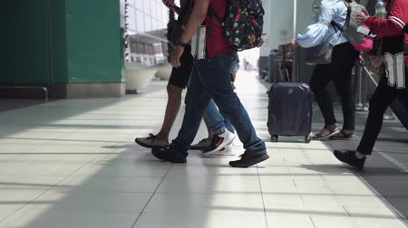 bavul : Malaysia, Kuala Lumpur, 13 july 2018. Unrecognizable people with baggages walking in terminal airport. slow motion. 3840x2160 Stok Video