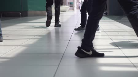 Malaysia, Kuala Lumpur, 13 july 2018. Unrecognizable people walking in terminal airport. slow motion. Close up. 3840x2160