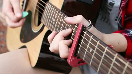 acoustical : Musician woman playing acoustic guitar. Shallow focus. Stock Footage