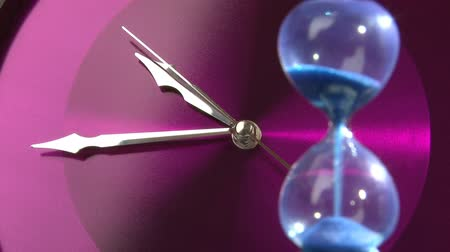 dövmek : Purple clock and hourglass, closeup