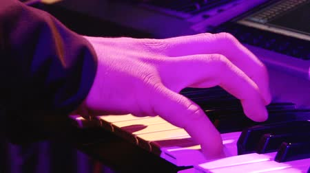 caz : Man play music keyboard, colorful light