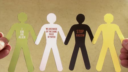 black yellow : Stop racism. Black and white (green! and yellow) paper people Stock Footage