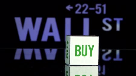 dobókocka : Rolling dice, two throws. Bye and Sell. Wall Street sign