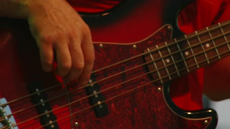playing band : Bass guitar, red, low light