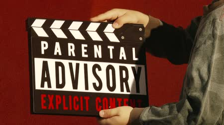 bordo : Boy with Clapperboard, Parental Advisory