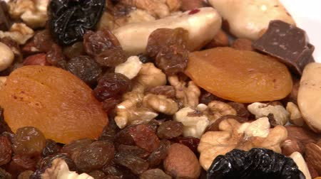 qualidade : Nuts, dried fruit, chocolate, pan left Stock Footage