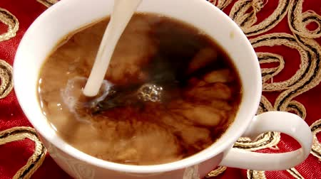 coffee brewing : Cup of coffee, pouring milk Stock Footage