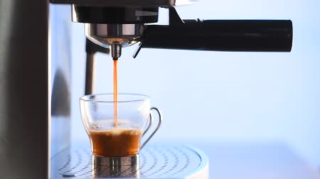 feketés csésze : Modern glass cup of black coffee brewing via a metal espresso machine, hd, 1080p high definition.