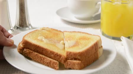 lét : A plate of hot buttered toast being set on the table Stock mozgókép