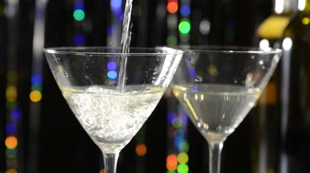 martini glasses : Dirty martinis being poured into glasses Stock Footage