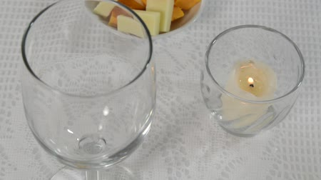 setting : Setting a table with a wine glass and a burning candle Stock Footage