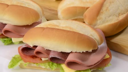 sandviç : A submarine sandwich with ingredients Stok Video
