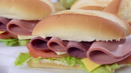 sandviç : Panning across a hogie sandwich with cold cuts and cheese Stok Video
