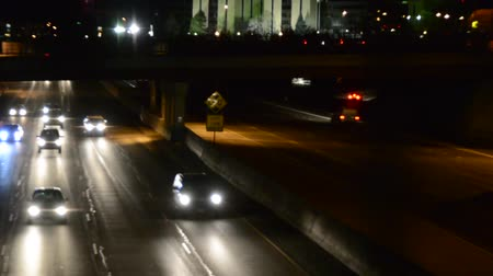 denver : Zoom out shot of freeway traffic in the city at night Stock Footage