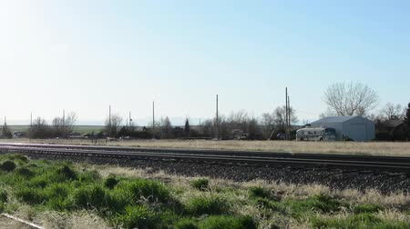 Pan across railroad tracks in a rural location