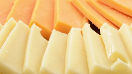 Pan across slices of swiss and cheddar cheeses