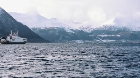 ferryboat : Ferry on the fjord with snow mountains, near volda (norway) Stock Footage